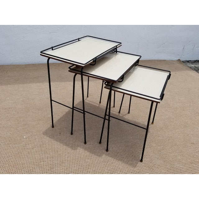 Vintage Mid-Century Modern Mathieu Mategot Style Nesting Tables . Features , black metal painted , brass feet and mica...