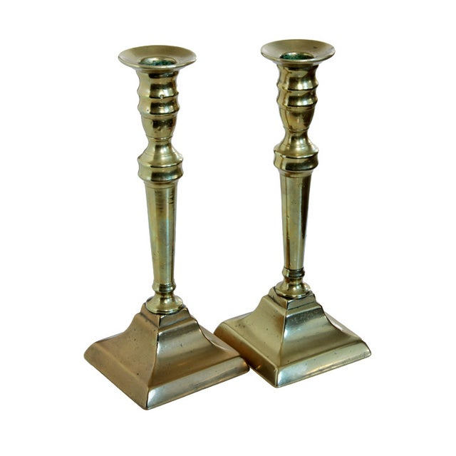 Add some elegance to your tabletop or mantel with this identical pair of neo-classical 18th century English candlesticks....