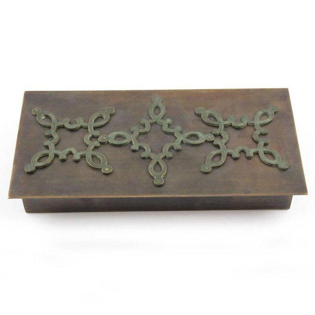 Elegant French 1940s modern elongated decorative lidded box. Beautiful geometric shape with modernist design. Heavy brass...
