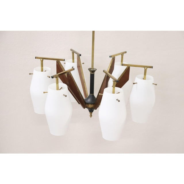 Beautiful and rare chandelier by Stilnovo Italian designer six arm with 6 lights. Solid brass structure, six arms with...