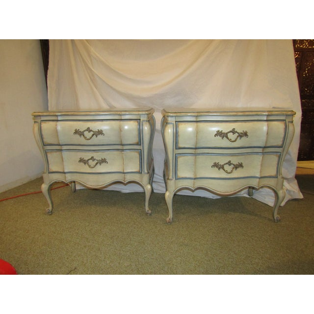 In an antique white with blue hand painted trim are the pair of Bombe chests. They can be nightstands or side tables,...
