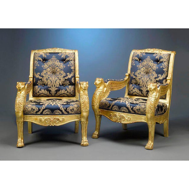 This magnificent pair of French giltwood armchairs is crafted in the manner of the Maison Jeanselme, the firm that created...