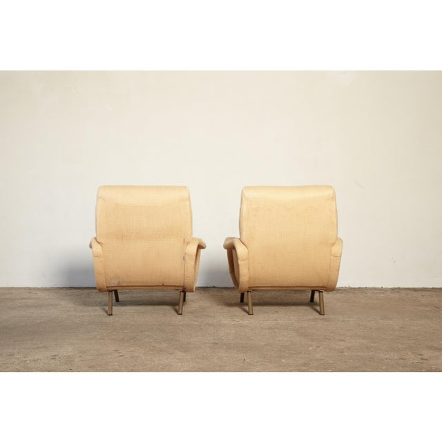 A pair of original and authentic Marco Zanuso Lady chairs, Arflex, France/Italy, 1960s. The upholstery is worn and stained...