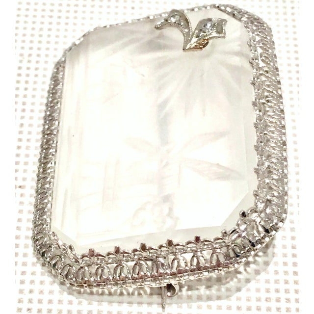 Antique Etched Rock Crystal & Diamond Platinum Set Filigree Brooch. This rare piece features a filigree platinum setting...