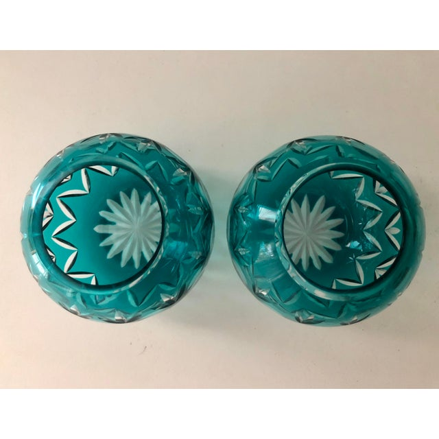 Beautiful votives in an aqua blue, cut to clear. Would also make for great vases. What color! These are bright and happy....