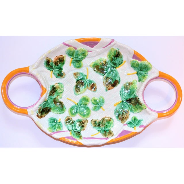 This is a great vintage Italian majolica platter with a beautiful rose and khaki double looped handle on either side. The...