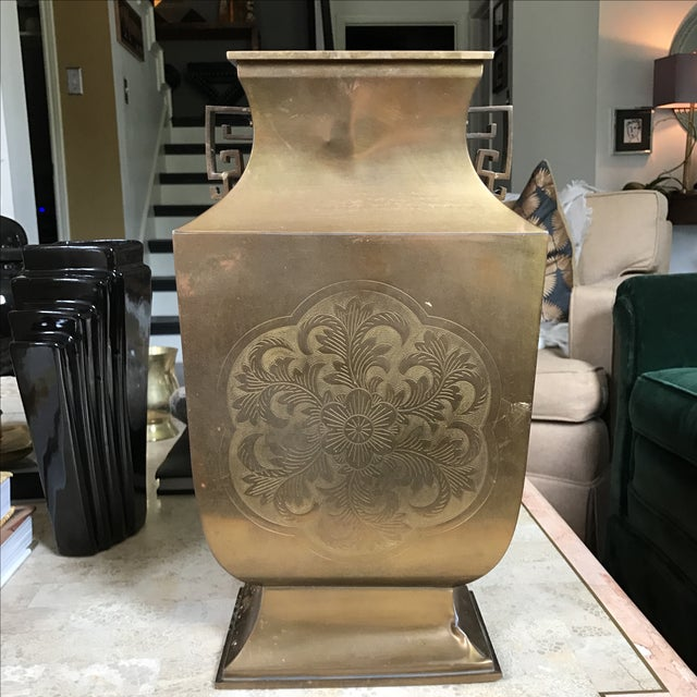 Offered is this elegant brass vase with etched floral detail. It has some dents and dings but is still very beautiful.