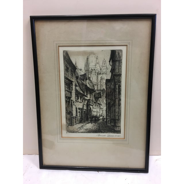 A very beautiful old Etching of a narrow European cobble stoned street with the large cathedral in the background....