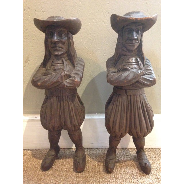 Pair of antique hand carved candle and matchstick holders. Period figural men in fruitwood by J. Martin Rennes .