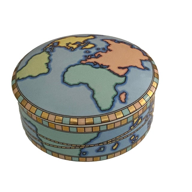 A round Tiffany & Co. Japan world box in blue with colorful continents.