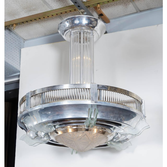 A very large French Art Deco round chandelier with fluted glass rod surround, tubular glass rod stem, and frosted art...