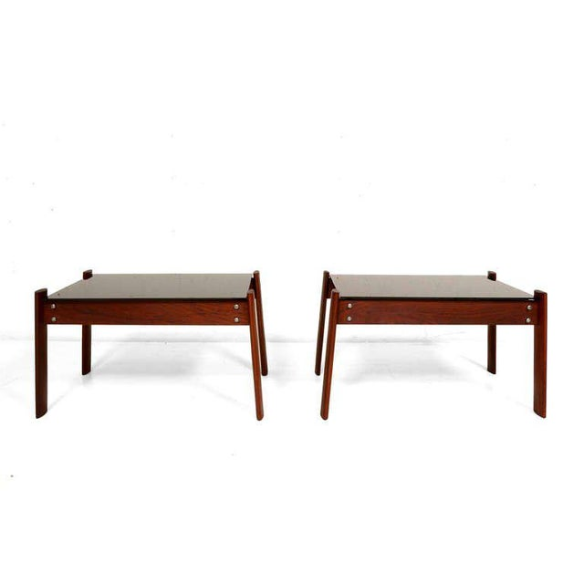 For your consideration a pair of side table by Percival Lafer. Solid jacaranda rosewood with new smoke glass top.