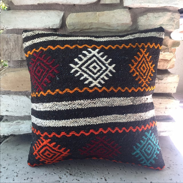 This is a lovely vintage Turkish kilim pillow cover. The back is made with new canvas fabric with a hidden zipper. The...