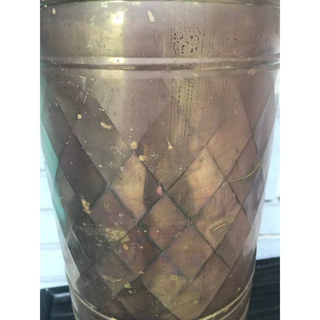This listing is for a brass O Rings umbrella holder stand. Perfect for the entry way! No makers mark. Some oxidation,...