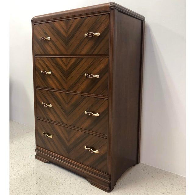 Beautifully restored Art Deco waterfall walnut chest of drawers / tallboy dresser. Features matchbook walnut veneers in a...