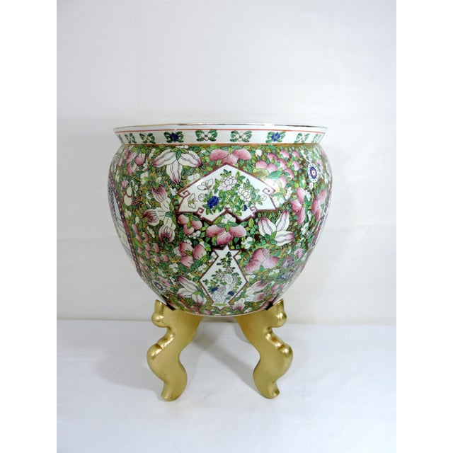 Mid 20th century goldfish bowl style planter on a gold two part wood stand. This is a nicely hand painted and enameled...