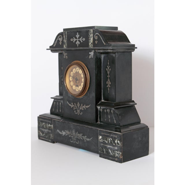 Beautiful Victorian French marble mantel clock circa 1880 with jet black nero belgio marble. This piece is in fabulous...