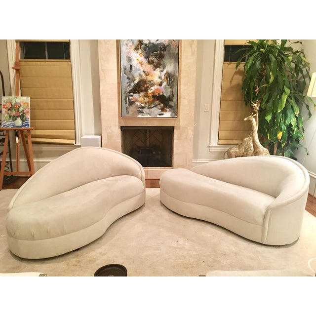 Custom made ultra suede modern white couches. Sold as a pair. Beautiful lines and curves. These couches Can be used...