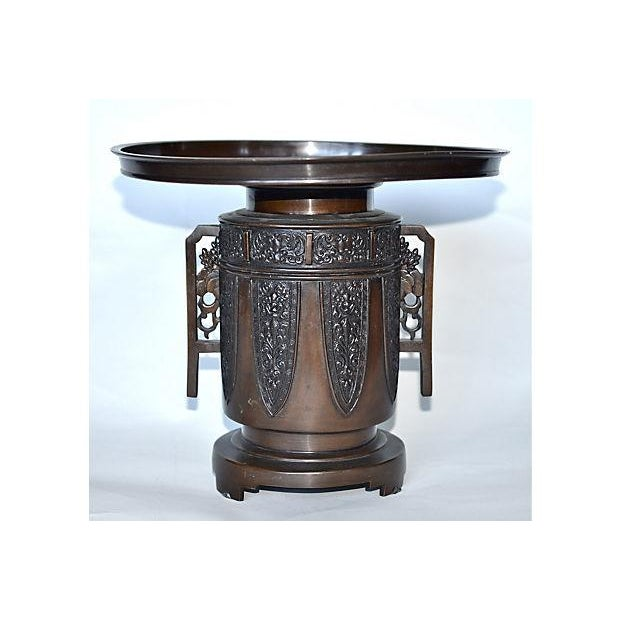 Antique Japanese bronze flower vase in two-parts, the removable upper section typically formed and set with a frog,...