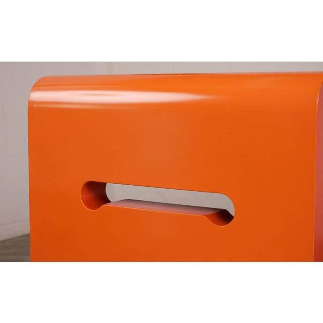 This 1970's modern Console table is stained in an orange/red combination and has a beautiful lacquered finish. The console...