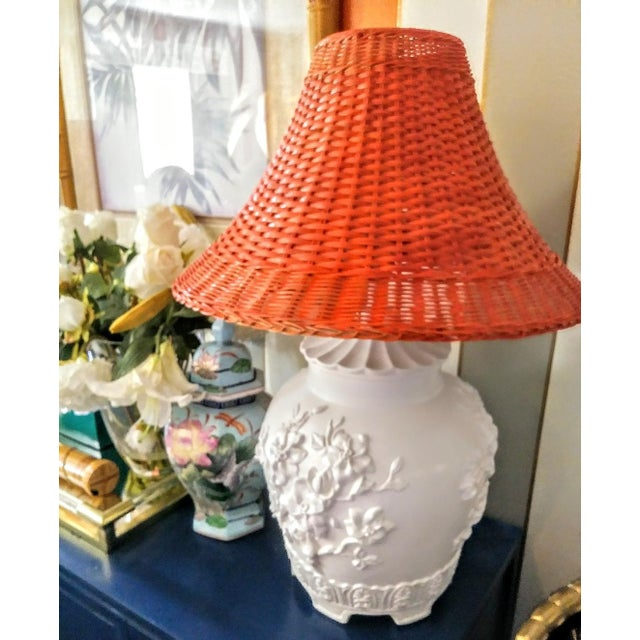 A Pair Vintage Floral Gloss White Large Pagoda Table Lamps W/Bright Orange Wicker Shades For Sale - Image 4 of 10