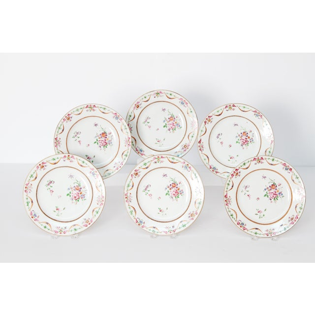 A set of six Chinese Export porcelain plates with ribbon swag around rim and floral sprigs in center. Rose and green on...