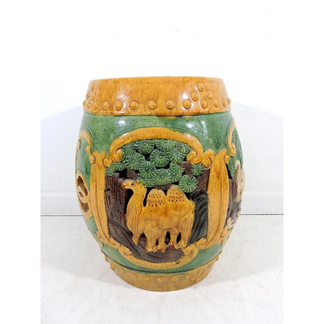 A very unusual and hard to find circumferential relief decorated Chinese garden seat or drum stool made in China in the...