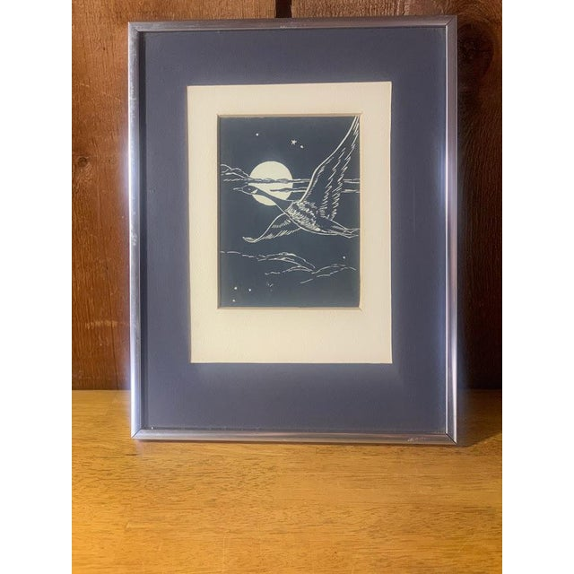 Gwen Frostic (1906-2001) Michigan artist and writer framed block print. This print features a goose in flight. The print...