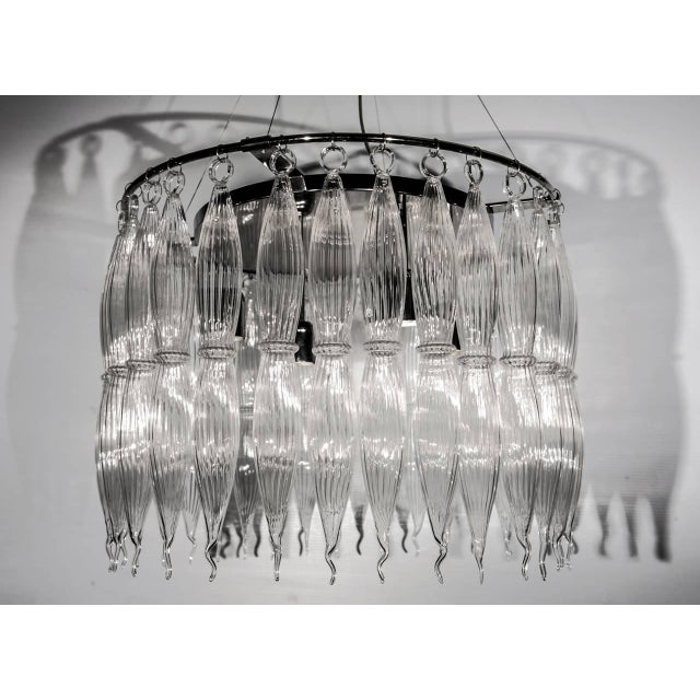 Vintage Italian chandelier with clear Murano glasses, mounted on chrome frame / Made in Italy circa 1960's 4 lights / E26...
