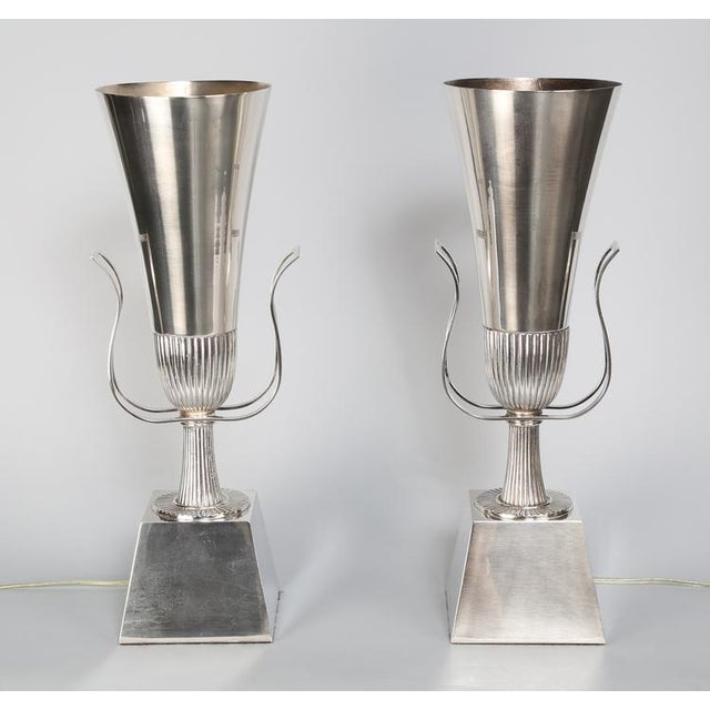 Elegant pair of Tommi Parzinger neoclassical urn-shaped, silver-plated table lamps for Lightolier's Heritage Silver...