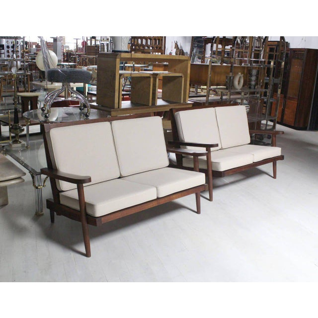 Pair of George Nakashima loveseats or sofas with new upholstery.
