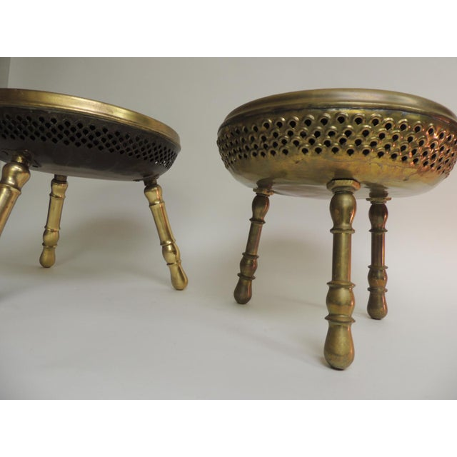 Pair of vintage low round tripod Indian low stools, tables or tabouret embossed floral design on top and pierced underside...