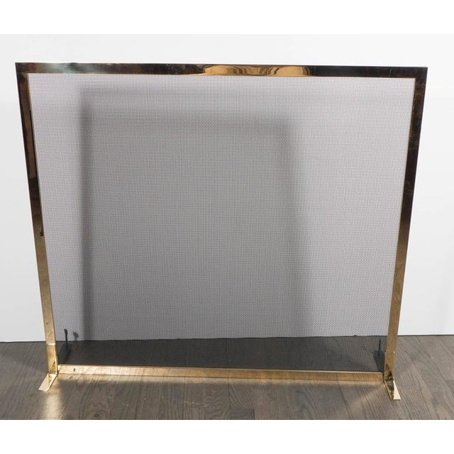 A gorgeous fire screen in polished and lacquered brass. A minimal design lends to the understated elegance of this piece....