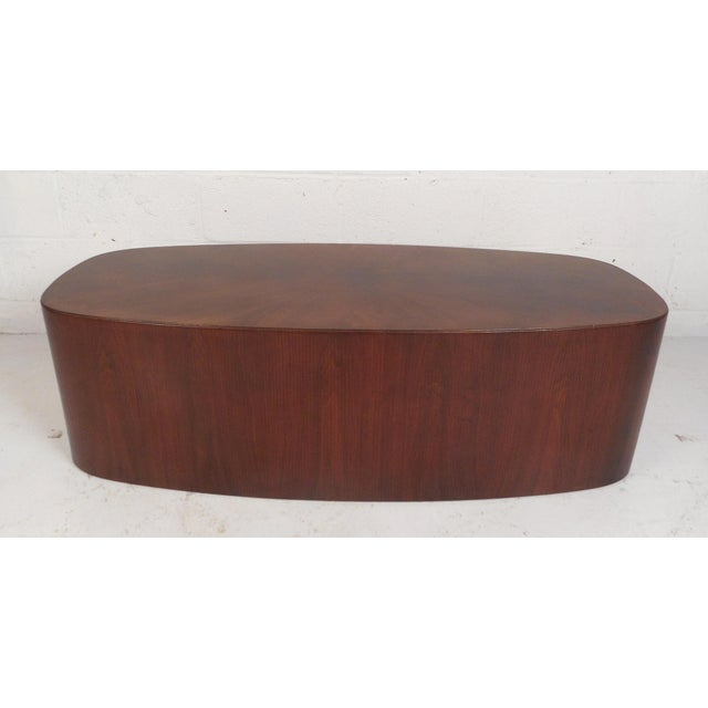 This beautiful vintage modern coffee table features unique wood grain on the top running in different directions. An oval...