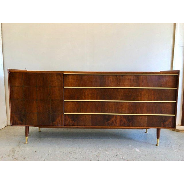One of the finest examples of mid century designs we've come across. This gorgeous vintage sideboard by Edmond Spence...
