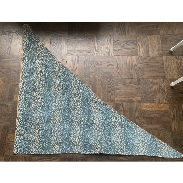 """Remnant of Cowtan & Tout blue cut velvet leopard fabric. Fabric measures at widest parts: 50""""h x 57"""" wide. Fabric will..."""