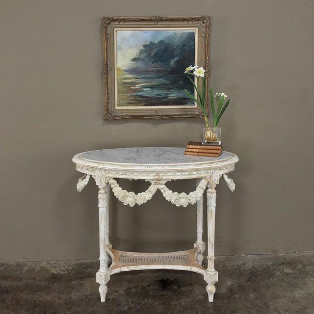 19th Century French Louis XVI Marble Top Table was exquisitely crafted in an oval shape making it suitable for almost any...