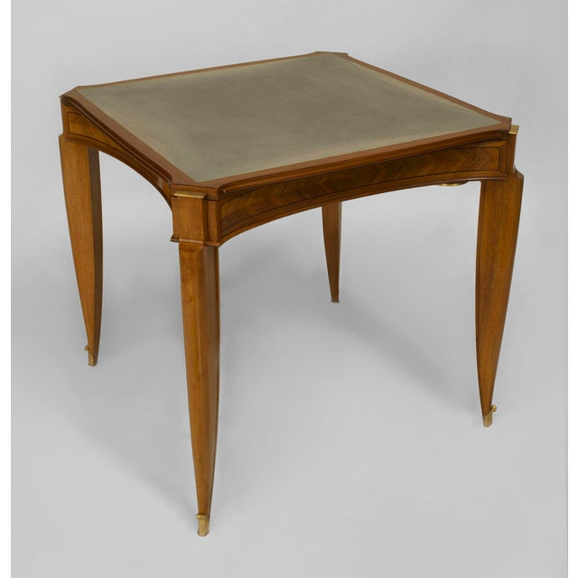 French Art Deco light mahogany square game table with a removeable parquetry top & ebonized banded inlay trim over a...