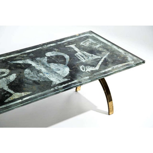 Dubé (Duilio Bernabe) coffee table. Fontana Arte, Italy, circa 1955. Reverse-painted crystal, brass. Dimensions: 42 W x 21...
