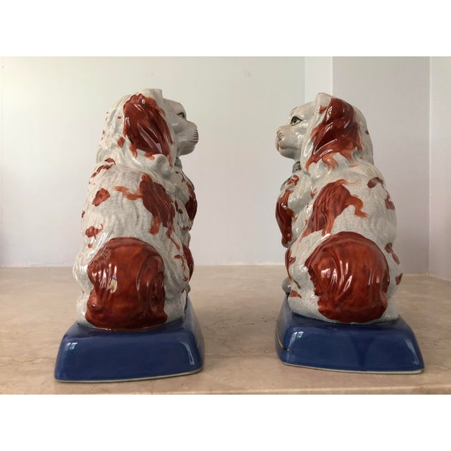 Vintage Staffordshire Dog set. Unique painting on each dog. Silver tone collar. Gold trim accent on base.