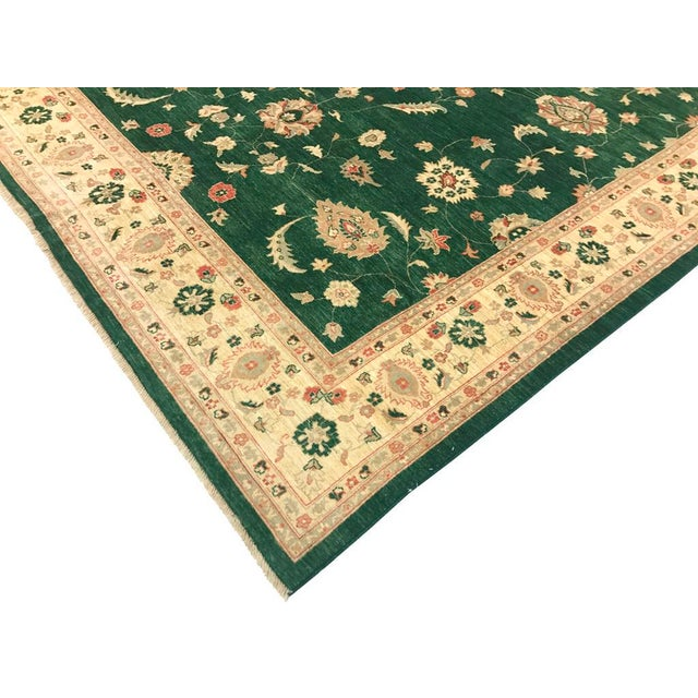Beautiful traditional green Peshawar hand knotted rug made with the finest wool and vegetable dyes will bring luxury and...
