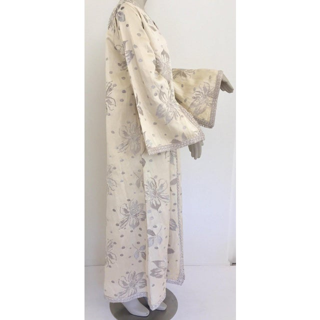 Stunning and elegant Moroccan caftan with silver metallic Moorish floral Dupioni silk brocade. Lavishly embroidered on a...