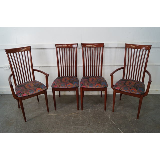 High quality, Italian made, set of 4 lacquer finish solid wood dining chairs consisting of 2 arm and 2 side chairs. They...