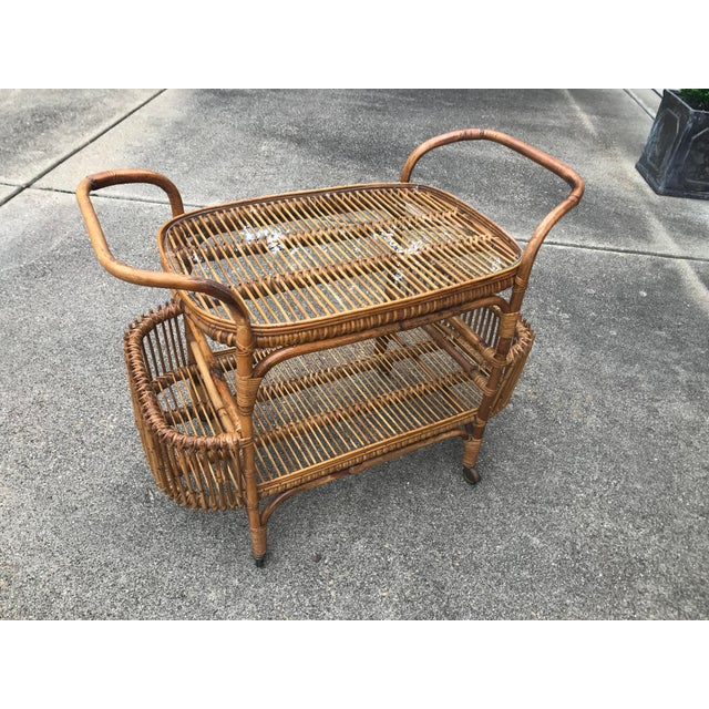A rattan and bamboo glass topped mid century bar cart on wheels. Perfect for drinks or use as a side table fits perfectly...