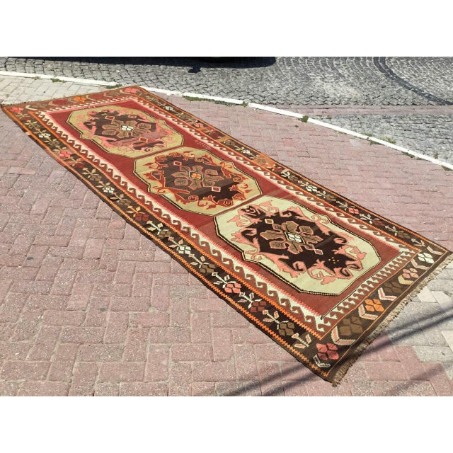 This beautiful, vintage, handwoven kilim Rug is handmade of very fine quality wool in all natural colors. It is as made in...