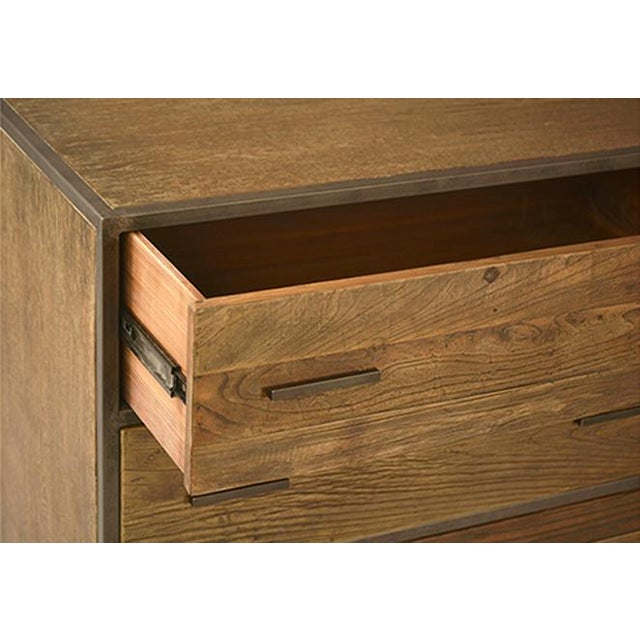 Wood and iron sideboard with six drawers and sleek iron frame and pulls. This sideboard mixes midcentury-modern with...