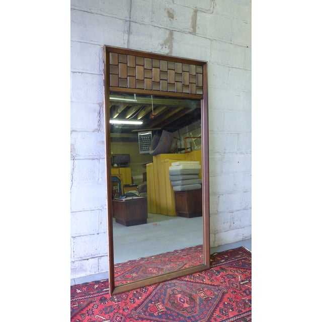 Mid Century Modern Brutalist style walnut mirror. One side of the mirror features alternating vertical and horizontal...