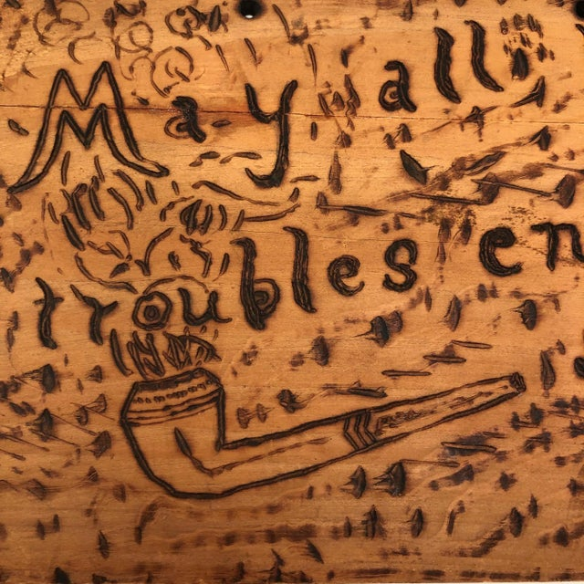 I'm pretty taken with this antique wooden sign decorated with pyrography, signed (burned) on the back with the initials of...