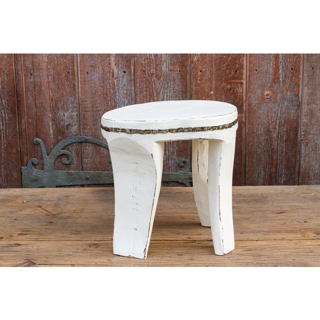 Decorative carved teak stool with thick top and chunky legs. Metal banding all around the top, it is beautifully carved...