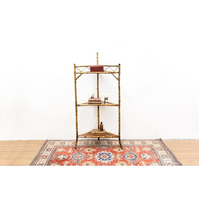 Up for sale is a 1890s Late 19th Century Bamboo & Lacquer Corner Stand Weight: 20 lbs Dimensions (in inches): L 24.25 x W...
